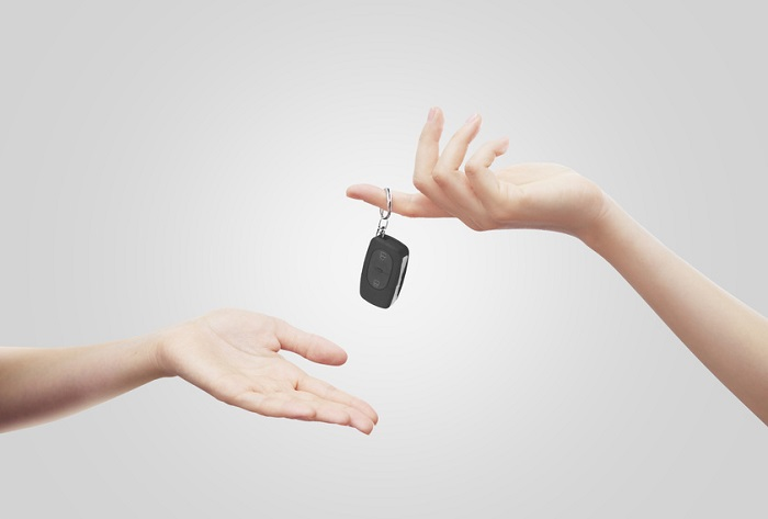 Hands Exchanging Car Keys